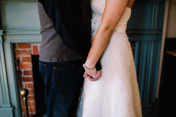 Holding hands forever... photograph in front of one of the fireplaces at Lynde House.